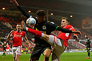 Timi Elsnik (19) of Swindon Town challenges Omar Sowunmi (17) of Yeovil Town with a high tackle during the EFL Sky Bet League 2 match between Swindon Town and Yeovil Town at the County Ground, Swindon, England on 10 April 2018. Picture by Graham Hunt.