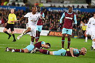 Andre Ayew of Swansea city has a shot at goal blocked by Aaron Cresswell and James Collins (r) of West Ham. Barclays Premier league match, Swansea city v West Ham Utd at the Liberty Stadium in Swansea, South Wales  on Sunday 20th December 2015.<br /> pic by  Andrew Orchard, Andrew Orchard sports photography.
