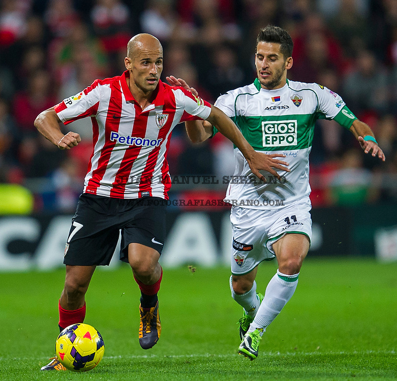 BILBAO, SPAIN - OCTOBER 31: Mikel Rico  (L) ofÊAthletic Club BilbaoÊcompetes for the ball with Ferran Corominas  (R) of Elche FC during the La Liga match betweenÊAthletic Club BilbaoÊandÊElche FCÊ<br /> atÊSan Mames Stadium<br /> on October 31, 2013 in Bilbao, Spain.  (Photo by Juan Manuel Serrano Arce/Getty Images)