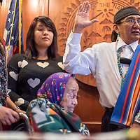 011315       Cable Hoover<br /> <br /> Rex Lee Jim stands with his family as he's sworn-in for an extended term as Navajo Nation vice president Tuesday in Window Rock.