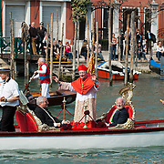 VENICE, ITALY - MARCH 25:  Ê The recently appointed Patriarch of Venice Francesco Moraglia sails the Grand Canal on an official gondola heading towards  St Mark's Cathedral on March 25, 2012 in Venice, Italy. The Patriarch of Venice is the smallest of the Italian dioceses but one of the oldest, created in 774. Three of the last seven Italian Pontiffs were Patriarch of Venice.  (Photo by Marco Secchi/Getty Images)