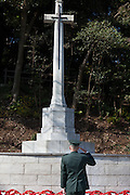 A military officer from the Japanese Self Defence Force (JSDF) lays a wreath and salutes during a ceremony for Remembrance Sunday at the Commonwealth War Graves Cemetery in Hodogaya, Yokohama, Japan. Sunday November 13th 2016. Each year representatives of the Commonwealth nations, along with American and other European nations that lost servicemen fighting the Japanese in World War 2, hold a multi-faith service of remembrance at this cemetery. This is the only cemetery for war dead in japan that is managed by the Commonwealth War Graves Commission.