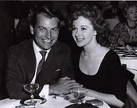 1957 Richard Egan & Susan Hayward dine at Ciro's Nightclub