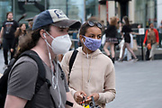 With most shops now open but with retail sales suffering due to the Coronavirus pandemic, shoppers wearing face masks, which became compulsory in shops on the 24th July, go out shopping in the city centre on 5th August 2020 in Birmingham, United Kingdom. Coronavirus or Covid-19 is a respiratory illness that has not previously been seen in humans. While much or Europe has been placed into lockdown, the UK government has put in place more stringent rules as part of their long term strategy, and in particular social distancing.