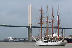 © Licensed to London News Pictures. 26/08/2015. Sail training ship Esmerelda approaches the QEII Bridge as she arrives in the capital for a port visit. The Chilean navy vessel is over 100 metres long and has four masts.  A number of tall ships have arrived in London today in rainy weather including the Chilean navy's four masted sail training ship Esmerelda. Other ships are heading to south east London for a tall ships event which is part of the Mayor of London's Totally Thames festival. Credit : Rob Powell/LNP