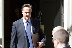 © Licensed to London News Pictures. 14/06/2013. London, UK. The British Prime Minister David Cameron leaves Downing Street in London today (14/06/2013) after meeting with Northern Irish First Minister Peter Robinson and Deputy First Minister Martin McGuinness to sign off an economic package for Northern Ireland in advance of the G8 summit. Photo credit: Matt Cetti-Roberts/LNP