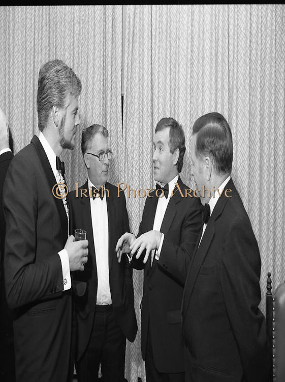 """People Of The Year Awards.1984..26.11.1984..11.26.1984..26th November 1984..The Tanaiste and Minister For Energy,Mr Dick Spring, presented a silver medallion and a scroll to eight men and one woman who were deemed to be """"People of the Year""""..The nine were selected by a panel of media editors.The awards were sponsored by New Ireland Assurance,Plc and presented at The Burlington Hotel,Dublin.The winners were:..Mr John Bermingham for his work in rehabilitating the physically and mentally handicapped..Ms Maeve Calthorpe for inspired work with the blind and visually impaired..Mr John Hume for his contribution to peace,democracy and the new Ireland Forum..Mr Patrick O'Connell, for fortitude in the face of grave illness and for fund raising..Drs Prem Puri and Barry O'Donnell,for their contribution to Medical Science..Mr Michael O'Hehir, for his contribution to broadcasting..Mr Fergal Quinn, for dynamic management in the public and private sectors..The special adjudicators award was given to Mr John Parker for his work in revitalising Harland and Wolff shipyard...Picture of Mr Fergal Quinn holding court with Mr Patrick O'Connell,Mr John Bermingham and Mr Michael O'Hehir"""
