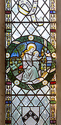 Stained glass window in church of Saint Margaret, South Elmham, Suffolk, England, UK c 1917 descent of Holy Spirit