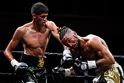 April 13, 2018 - Minnesapolis, MN, USA - Sebastian Fondora, of Coachella, Calif., connects a left hook against Veshawn Owens, of Minneapolis, during their welterweight fight at the Armory in Minneapolis on Friday, April 13, 2018. Fondora won by TKO. (Credit Image: © Aaron Lavinsky/TNS via ZUMA Wire)