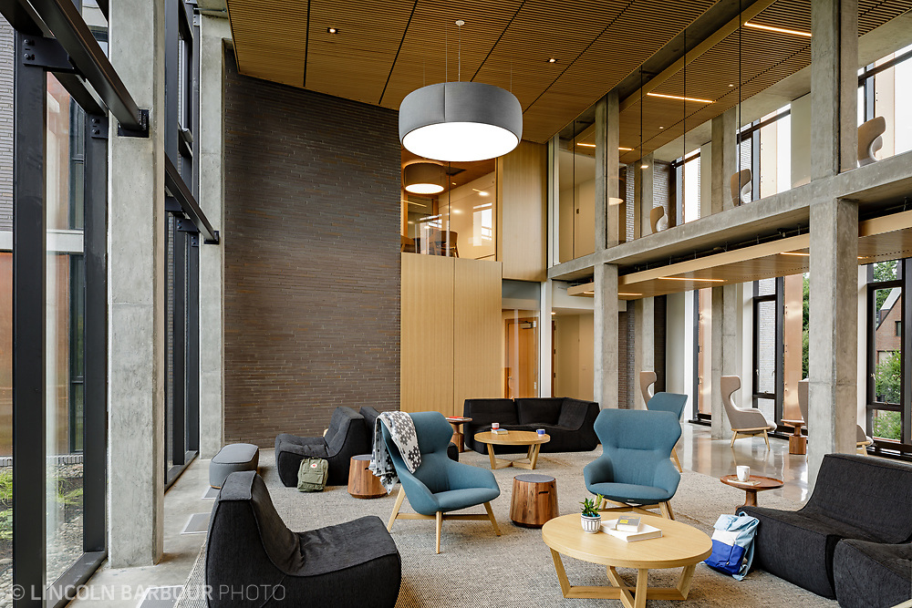 A large common area with modular furniture in Trillium Residence Hall at Reed College in Portland, Oregon.