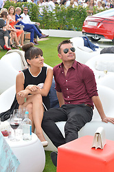 GREG BURNS and ROXANNE PALLETT at the Audi International Polo at Guards Polo Club, Windsor Great Park, Egham, Surrey on 26th July 2014.