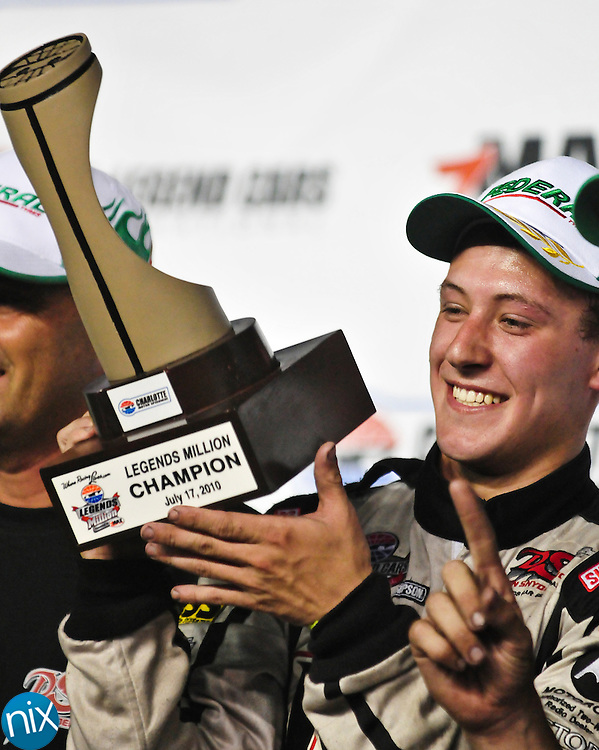 Daniel Hemric, from Kannapolis, holds up his trophy after winning the Legends Million race at Charlotte Motor Speedway Saturday night.