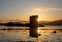 The sun setting behind Castle Stalker on the Spring Equinox 2020. Castle Stalker is situated on Loch Laich an inlet of Loch Linnhe, Argyll, Scotland…. (c) Stephen Lawson | Edinburgh Elite media
