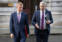 © Licensed to London News Pictures. 15/12/2020. London, UK. Culture Secretary Oliver Dowden (L) talks with Chief Secretary to the Treasury Steve Barclay as they leave the Foreign Office after attending a Cabinet meeting. London and other areas of the south east are to enter Tier Three restrictions at midnight tonight as Covid-19 infection rates rise. Photo credit: Peter Macdiarmid/LNP