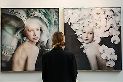 © Licensed to London News Pictures. 21/01/2020. London, UK. A woman views Isabelle Van Zeijl's artwork titled 'For Me' (R) and 'I Love her' (L) during the preview of London Art Fair at Business Design Centre in north London. The fair opens on 22 January and runs until 26 January, which showcases modern and contemporary artwork from galleries around the world. Photo credit: Dinendra Haria/LNP