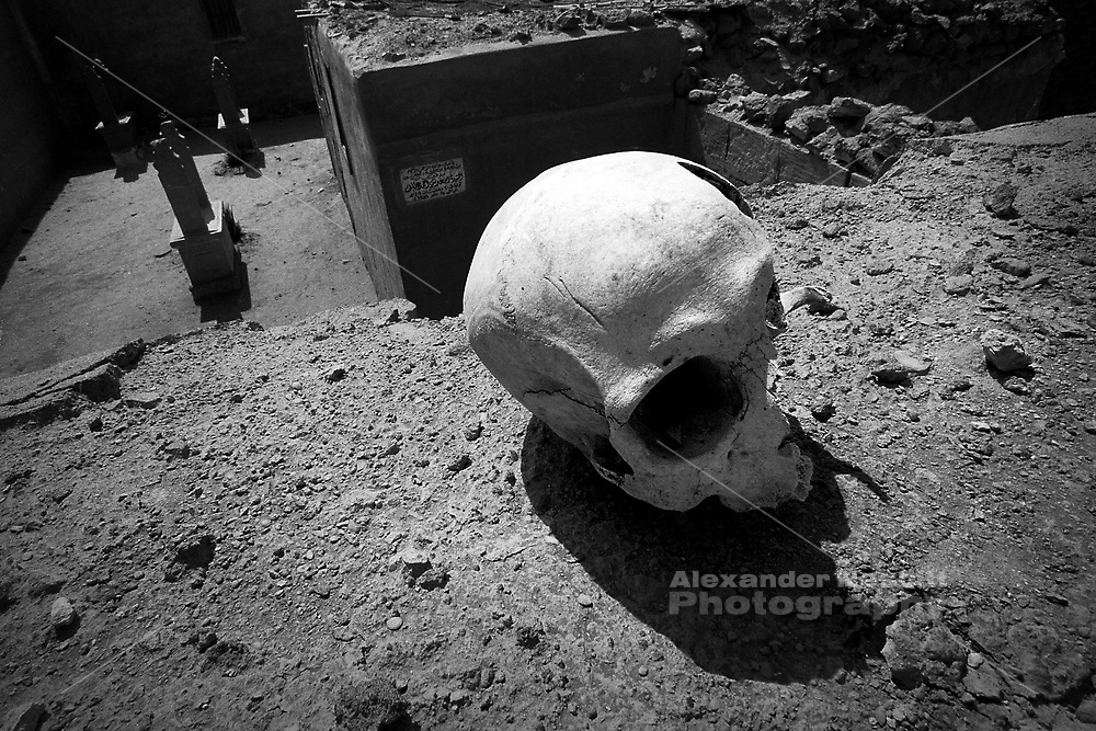 Cairo, Egypt, The City of the Dead, 1998 - skull found in the collapsed debris of a tomb.