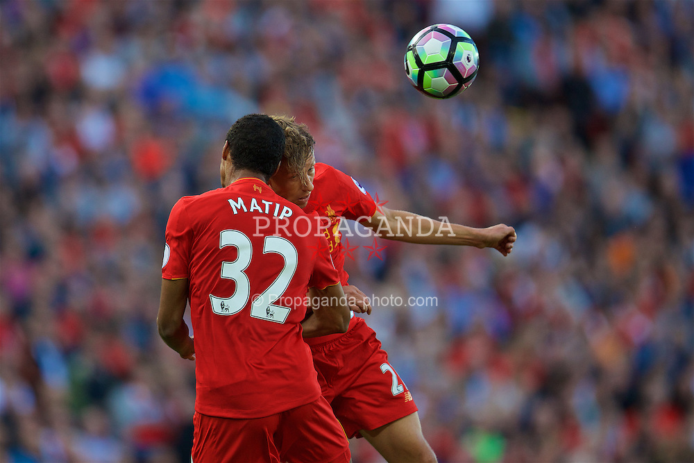 LIVERPOOL, ENGLAND - Saturday, September 10, 2016: Liverpool's Lucas Leiva and Joel Matip in action against Leicester City during the FA Premier League match at Anfield. (Pic by David Rawcliffe/Propaganda)