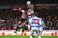 Brentford Midfielder Romaine Sawyers (19) and Queens Park Rangers Midfielder Pawel Wszolek (23) battle for the ball during the EFL Sky Bet Championship match between Brentford and Queens Park Rangers at Griffin Park, London, England on 2 March 2019.