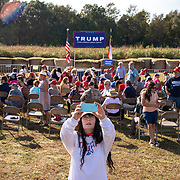 MONROE, NC - OCT 8:  A Trump supporter takes a selfie at Aw Shucks Farms before a campaign rally for U.S. President Donald Trump in Monroe, North Carolina on October 8, 2020. Since President Trump was infected with COVID-19, his son, Eric Trump, will be continuing on the campaign trail in swing states across the country as a way to continue momentum into Election Day while the president recovers.  (Photo by Logan Cyrus for The Washington Post)