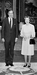 American President George Bush stands next to Queen Elizabeth II, in the Picture Room at Buckingham Palace