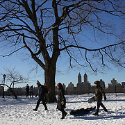A winter walk in Central Park after New York City was hit with over 7 inches of snow during its first winter storm of the year. Central Park, Manhattan, New York, USA. 4th January 2014 Photo Tim Clayton