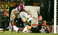Photo: Frances Leader.<br />Fulham v West Ham. The Barlcays Premiership.<br />17/09/2005.<br />West Ham's Marlon Harewood scores his first goal against Fulham with an injured leg.
