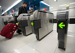 Modern ticket barriers at new Airport Express subway station in central Beijing China