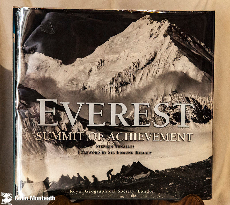 EVEREST - SUMMIT OF ACHIEVEMENT - Stephen Venables with a Foreword by Sir Edmund Hillary, Allen & Unwin, Australia, 2003, 1st Edn., ,   large format hardcover, colour & B&W plates, VG+ dustjacket in glassine cover, This copy flat signed on title page 'Ed Hillary'- A classic - if you only ever want to own one book about Everest, then this is it.   - $NZ375.