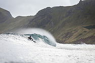 Patagonia surf ambassador Dan Malloy surfing in Alaska during a boat based surfing adventure aboard the m/v Milo with Ocean Swell Ventures.