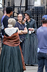 """Moray Place in Edinburgh's Georgian old town was turned into 19th century London for Julian Fellowes' new ITV show """"Belgravia"""".<br /> <br /> Pictured: Tamsin Greig (striped dress) seems to hold her nose at the smell of horse manure<br /> <br /> Alex Todd 