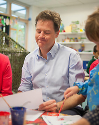 © Licensed to London News Pictures. 01/05/2014. Surbiton, UK. Nick Clegg paints a picture with children. Deputy Prime Minister Nick Clegg visits Lime Tree Primary School in Surbiton today 1st May 2014. Whilst there he took part in a painting, phonics and maths projects with school children. Photo credit : Stephen Simpson/LNP