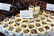 Puccini Bomboni chocolate shop selling exotic Calvados liqueur flavour chocolates in stylish display as treats, Amsterdam, Holland