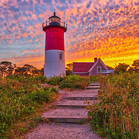 Cape Cod Nauset Beach Light is one of the most iconic Cape Cod lighthouses. It is located in the town of Eastham, Massachusetts next to Nauset Beach and not far from Coastguard Beach along the Cape Cod National Seashore. Visiting Cape Cod and the Islands is always a lot of fun. I finally was able to head out to photograph Nauset Lighthouse at sunset when the sky exploded into beautiful colors. <br />