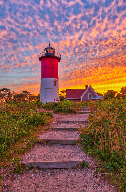 Cape Cod Nauset Beach Light is one of the most iconic Cape Cod lighthouses. It is located in the town of Eastham, Massachusetts next to Nauset Beach and not far from Coastguard Beach along the Cape Cod National Seashore. Visiting Cape Cod and the Islands is always a lot of fun. I finally was able to head out to photograph Nauset Lighthouse at sunset when the sky exploded into beautiful colors. <br /> New England Cape Cod lighthouse fine art photography images are available as museum quality photography prints, canvas prints, acrylic prints or metal prints. Fine art prints may be framed and matted to the individual liking and decorating needs:<br /> <br /> https://juergen-roth.pixels.com/featured/cape-cod-sunset-at-nauset-beach-light-juergen-roth.html<br /> <br /> All New England photos are available for photography image licensing at www.RothGalleries.com. Please contact Juergen with any questions or request. <br /> <br /> Good light and happy photo making!<br /> <br /> My best,<br /> <br /> Juergen