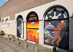 Street art project Openclose Dundee using art on doors in out of the way alleyways and lanes by local artists in the city. Dundee,Scotland, UK. L to R; Bleach Artwork, FYZN,BFL.