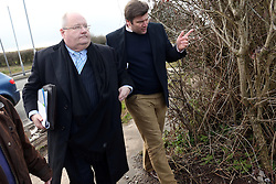 © Licensed to London News Pictures. 26/02/2015. Wells, UK Eric Pickles, Secretary of State for Communities and Local Government, with Conservative Candidate for Wells constituency James Heappey, looking at Green field sites in Wells today 26th February 2015, which may be developed into housing in the future . Photo credit : Jason Bryant/LNP