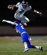 Rancho Cucamonga's Quentin Moten hurdles over Westlake's Zach Hale at Westlake High School on Sept. 20 2019.