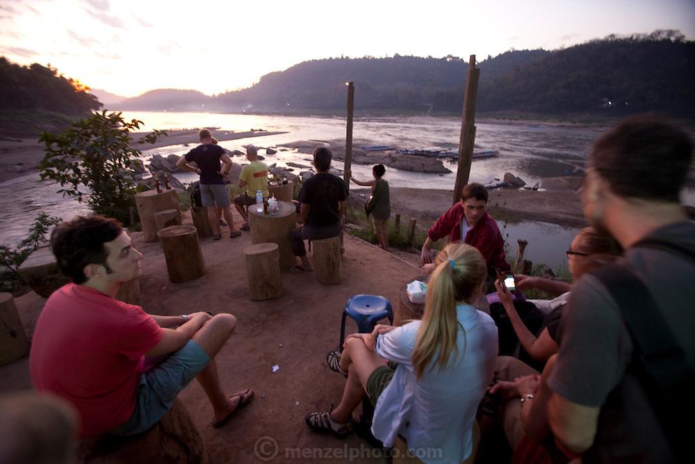 Sunset bar across the bamboo bridge on the Nam Khan River in Luang Prabang, Laos.