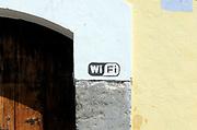 WiFi sign on a wall. Antigua Guatemala, Republic of Guatemala. 02Mar14