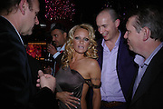 Pamela Anderson, James bradbury and Mark Moody. Selfridges Las Vegas dinner hosted by  hon Galen , Hillary Weston and Allanah Weston. Selfridges Oxford St. 20 April 2005. ONE TIME USE ONLY - DO NOT ARCHIVE  © Copyright Photograph by Dafydd Jones 66 Stockwell Park Rd. London SW9 0DA Tel 020 7733 0108 www.dafjones.com