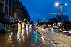 Edinburgh, Scotland, UK. 31 December 2020. Scenes of empty streets at night on Hogmanay in Edinburgh City Centre.Pre Covid-19 pandemic , the city was famous for its street entertainment on New Year's Eve and attracted many thousands of tourists every year to enjoy the New Year celebrations. Pic; Princes Street is empty. Iain Masterton/Alamy Live News