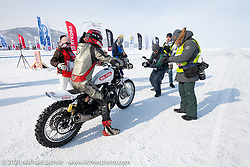Mikhail Lyubimov on his Harley-Davidson Sportster that he got to 164 kmh (102 mph) on the mile-long ice track in the Baikal Mile Ice Speed Festival. Maksimiha, Siberia, Russia. Saturday, February 29, 2020. Photography ©2020 Michael Lichter.