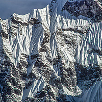 Fluted snow ridges drape the side of a mountain in the Khumbu region of Nepal's Himalaya.