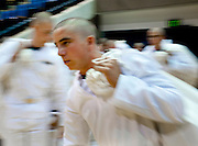 "Incoming midshipmen move along in the intake process on their first day at the U.S. Naval Academy in Annapolis, MD. Approximately 1,230 young men and women arrived at the U.S. Naval Academy's Alumni Hall, Thursday, July 1, for Induction Day to begin their new lives as ""plebes"" or midshipmen fourth class (freshmen). ""I-Day"" culminates when the members of the Class of 2014 take the oath of office at a ceremony at 6 p.m. in Tecumseh Court, the historic courtyard of the Bancroft Hall dormitory. Over 17,400 young men and women applied to be members of the Naval Academy Class of 2014 - a record for USNA."