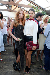 Left to right, CLARA PAGET and SARAH ANN MACKLIN attending the Warner Bros. & Esquire Summer Party held at Shoreditch House, Ebor Street, London E1 on 18th July 2013.