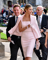 Nick Candy and Holly Candy arrive for the wedding of Princess Eugenie to Jack Brooksbank at St George's Chapel in Windsor Castle.