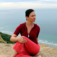 USA, California. Natural healthy woman in her 40's, outdoors, in yoga pose.