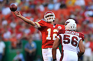 Quarterback Brodie Croyle (12) of the Kansas City Chiefs throws down field in the first quarter against pressure from Arizona Cardinals linebacker Chike Okeafor (56) at Arrowhead Stadium in Kansas City, Missouri on August 16, 2008.....