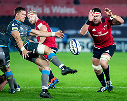 Shaun Venter of Ospreys clears despite the attentions of Billy Holland of Munster <br /> <br /> Photographer Simon King/Replay Images<br /> <br /> European Rugby Champions Cup Round 1 - Ospreys v Munster - Saturday 16th November 2019 - Liberty Stadium - Swansea<br /> <br /> World Copyright © Replay Images . All rights reserved. info@replayimages.co.uk - http://replayimages.co.uk