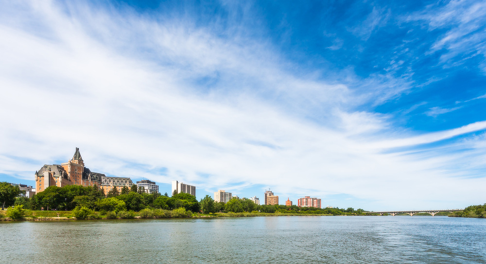 The South Saskatchewan River complements Saskatoon's skyline and <br /> histoic landmarks including the Bessborough Hotel and University <br /> Bridge.